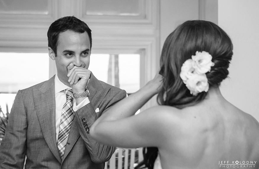 Photo of a grooms face during the first look.