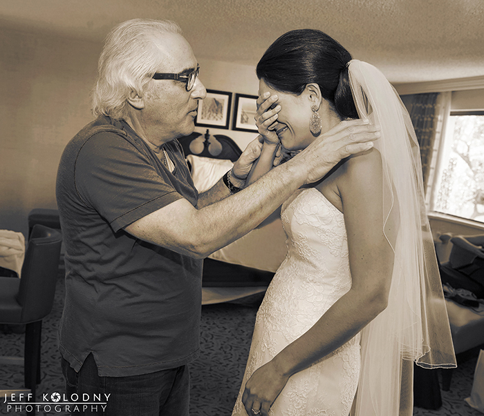 Emotional first look between bride and her father.