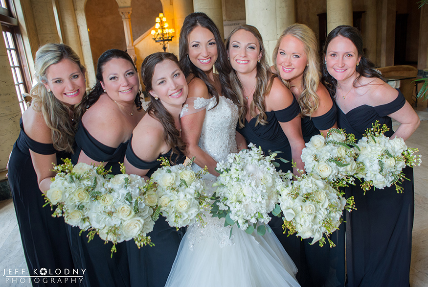 Bride and her bridesmaids group picture taken in the lobby of the Biltmore Hotel.