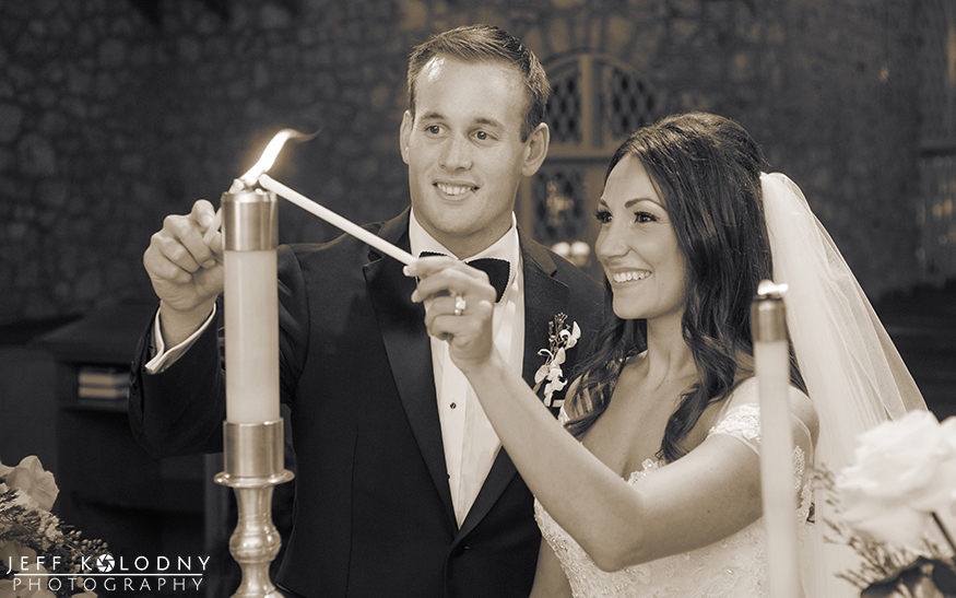 Bride and groom lighting the unity candle at the Plymouth Congregational church in Coral Gables