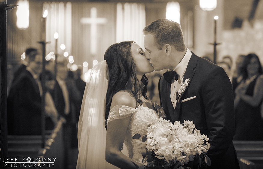 Bride and Groom kiss at the Plymouth Congregational church.